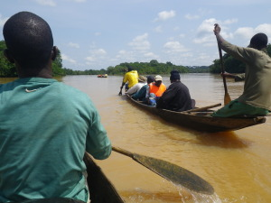 Researchers travelling down the Djerem River in central Cameroon to reach a field site deep in Mbam et Djerem National Park.