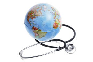 World Globe and Stethoscope on White Background