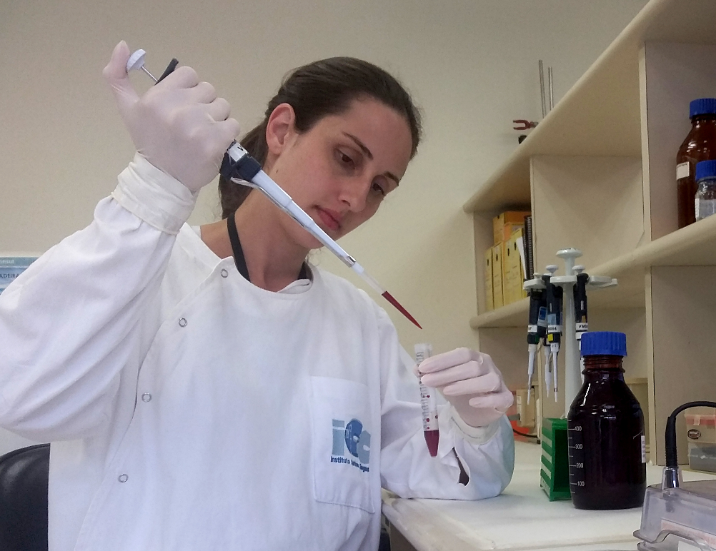 Dr Camila Zanluca, PhD, working in Claudia's lab