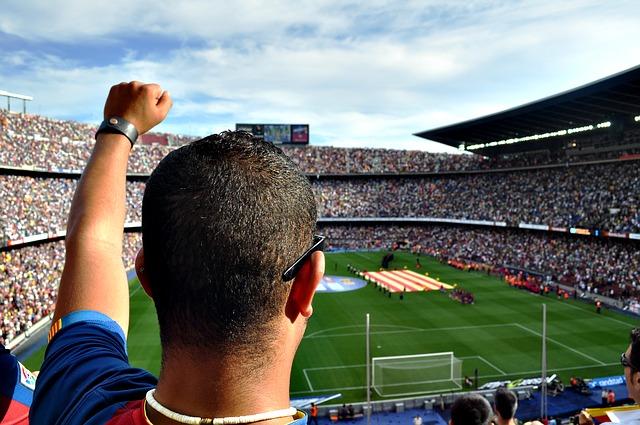 Man cheering at football