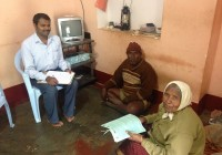 Field investigator collecting data from NCD patient (2)