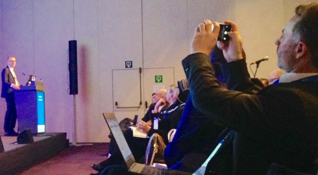 The author (right), photographed while photographing Gottfried Hirnschall of the World Health Organization at an historic ILC session addressing the WHO viral hepatitis elimination targets.
