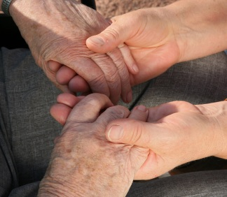Young and old hands clasping